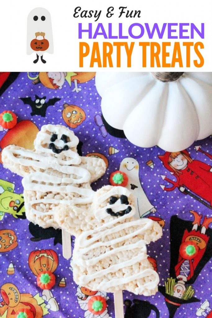 Rice krispie Halloween treats for kids. Little ghost mummies covered in white chocolate and served on sticks.