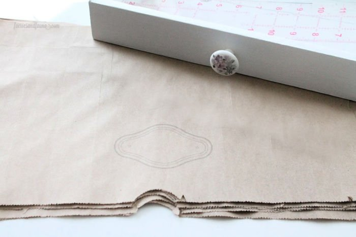 Free printable labels on a brown paper drawer liners.