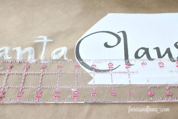 Lining up the letters for a Scroll sign craft