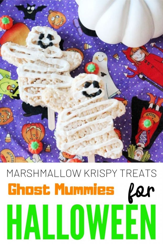 Sweet Halloween treats for kids shaped like ghosts with white chocolate drizzle and not scary faces.