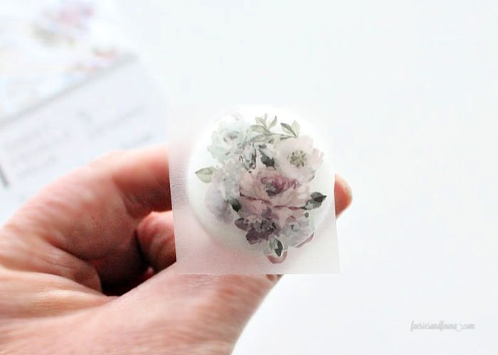 A craft room organizer gets some pretty drawer knobs with Prima transfers