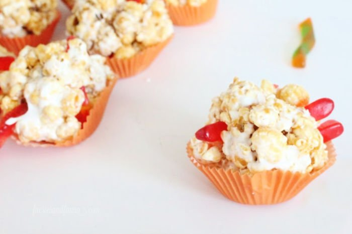 Gummy worm easy popcorn ball recipe for kids. Great Halloween treats for Halloween school parties, made with marshmallows and caramel corn.