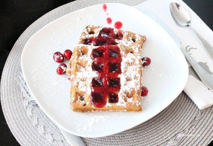 Homemade Cranberry syrup recipe served on waffles