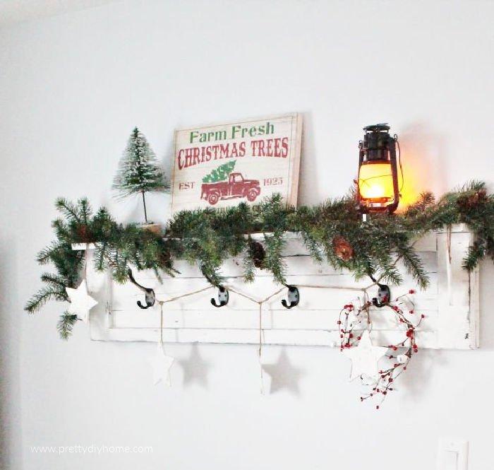 White farmhouse shelf decorated for Christmas