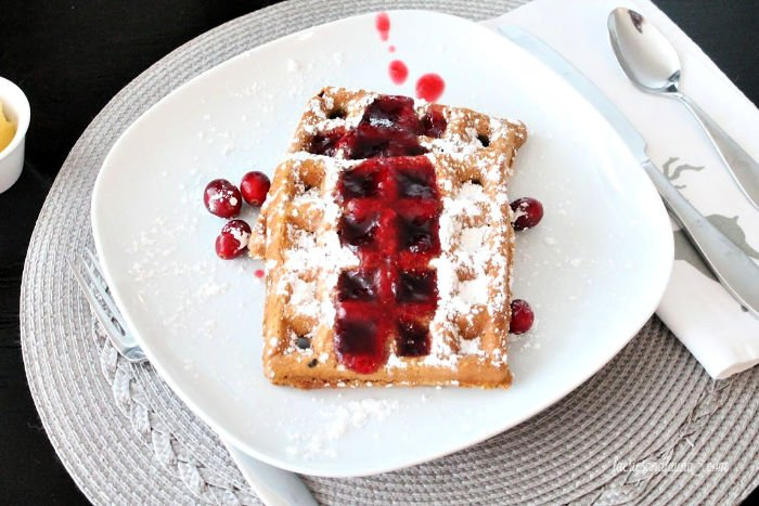Gingerbread waffles with cinnamon and cranberry syrup.