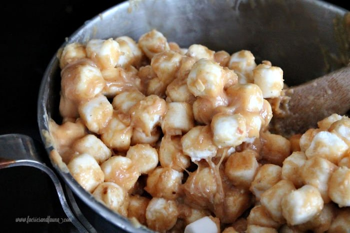 Adding marshmallows to a one pot no bake peanut butter square recipe.