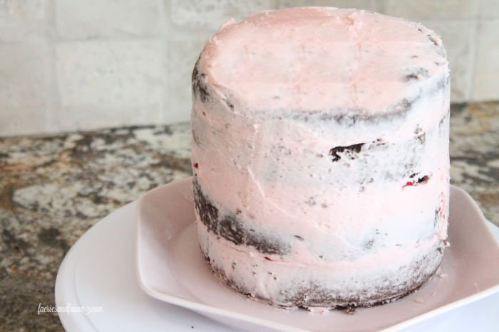 crumb coat on a chocolate strawberry cake for Valentines dessert.