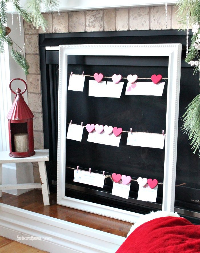 A DIY string frame displaying Valentine coupons for Valentines day decor and Valentines gift