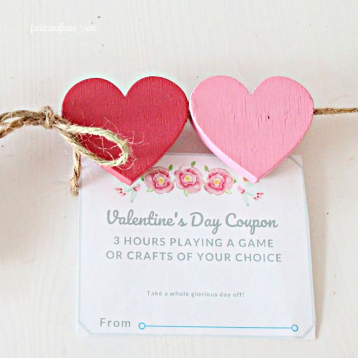 Family Valentine coupon hung on a Valentines display for Valentines day.