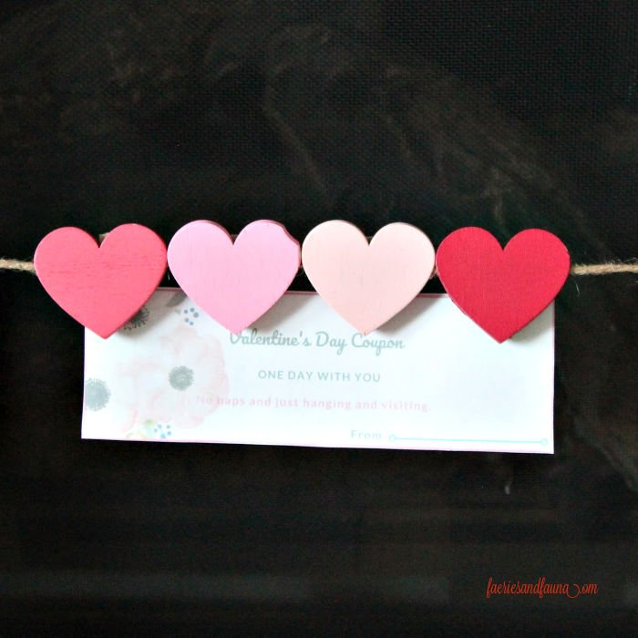 Valentine coupon hung on a jute string frame for Valentines day gift giving.