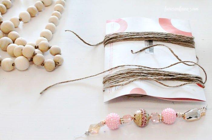 Making twine tassels for a DIY farmhouse wood bead garland.
