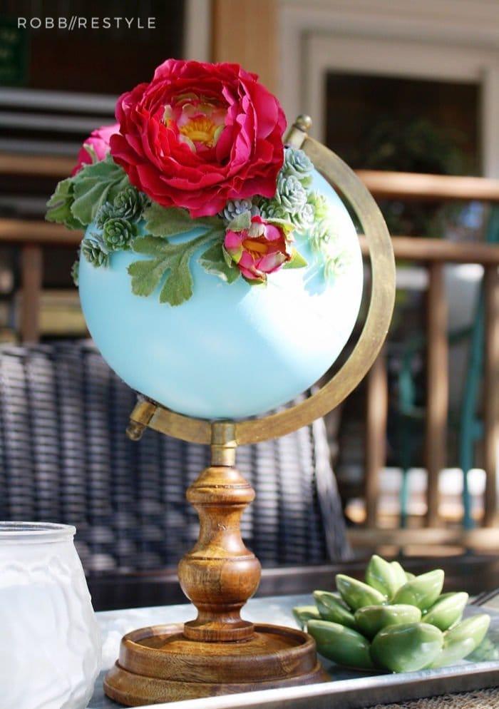DIY Spring decor idea using an repurposed globe. and flowers.