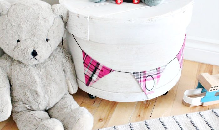 Vintage wooden cheese box makeover into toy storage. A pretty farmhouse upcycle project using an old wooden round cheesebox