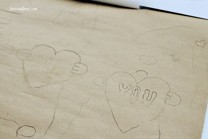 Traced patterns using carbon paper. A gnome Valentine craft for kids with gnomes.