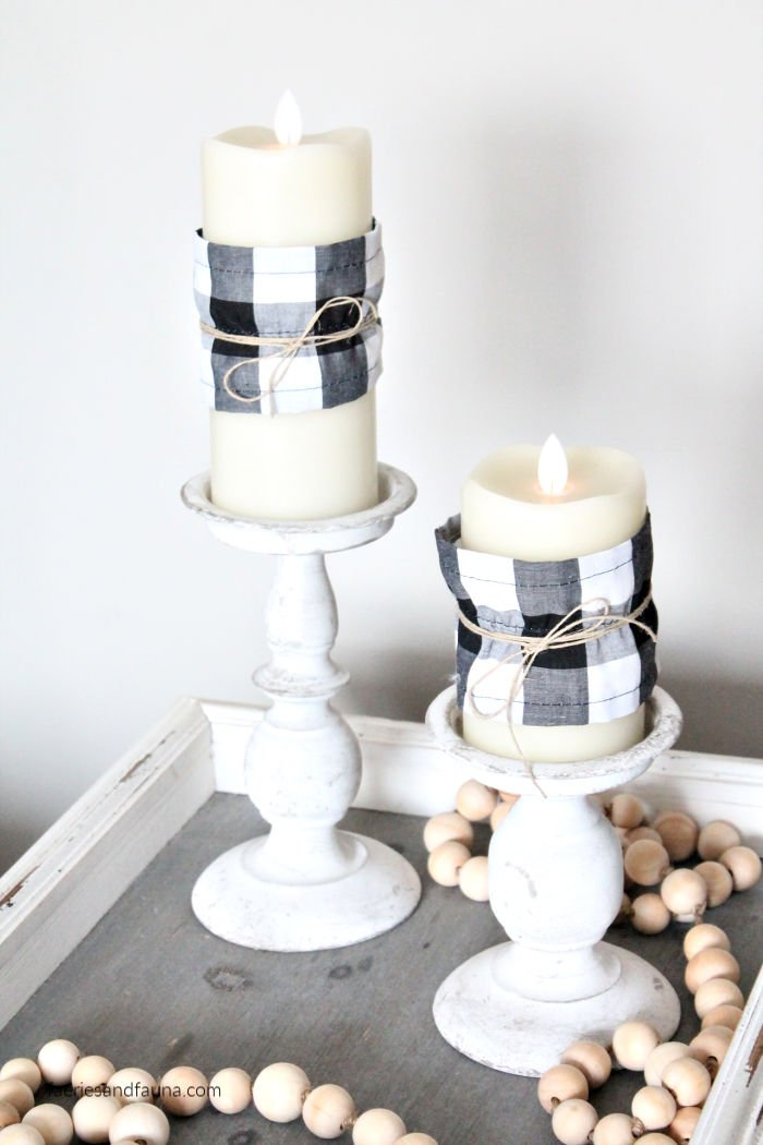 Two flameless candles with buffalo check candle covers. An easy sewing project for beginners.