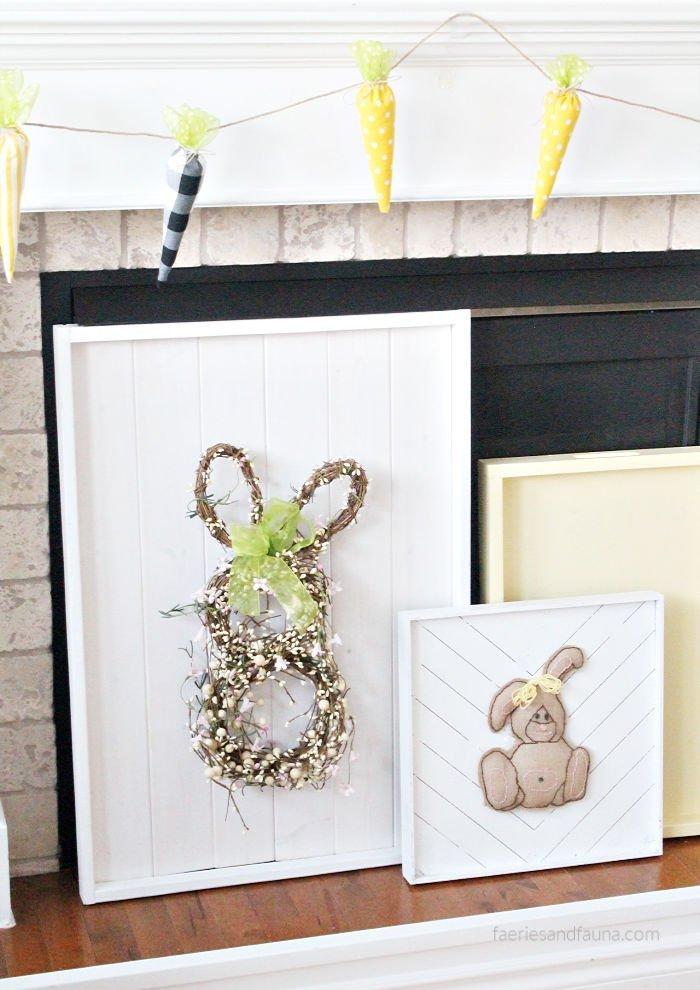 DIY Easter decor using shiplap and Easter bunny wreath to cover the front of a fireplace.