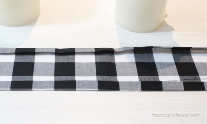An easy sewing project for beginners using scrap buffalo check fabric. How to press and seam the two outer hems.