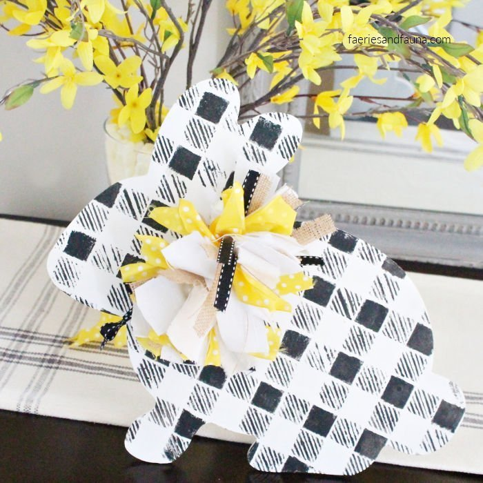 Handmade wooden Easter bunny with buffalo check plaid pattern and a messy bow.