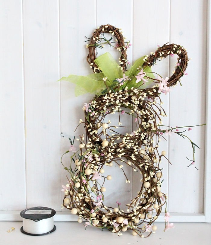 Supplies for making a Easter farmhouse wreath and shiplap backdrop.