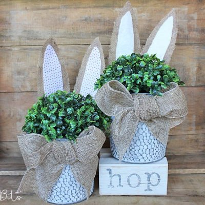 Easter bunny planters with pretty burlap bows.