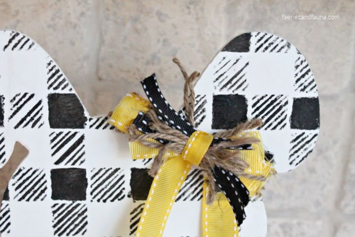 How to make a small messy bow using ribbon, twine and fabric.