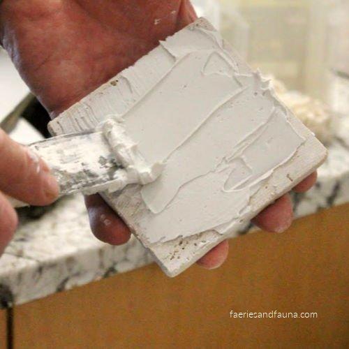Adding tile adhesive
