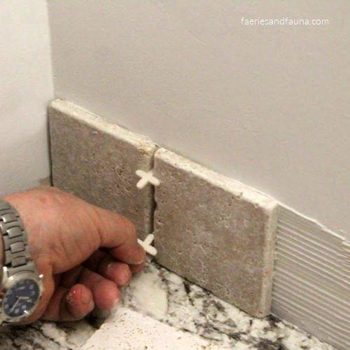 Placing tile on a back splash