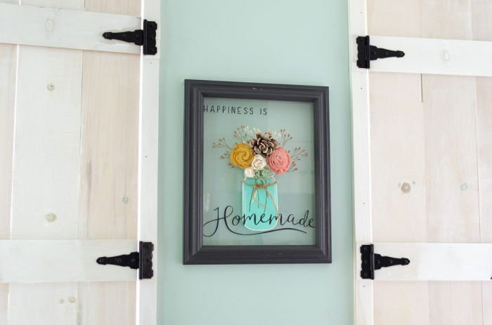 A thrift store DIY picture frame craft idea with a thrift store frame and stenciled artwork on glass.