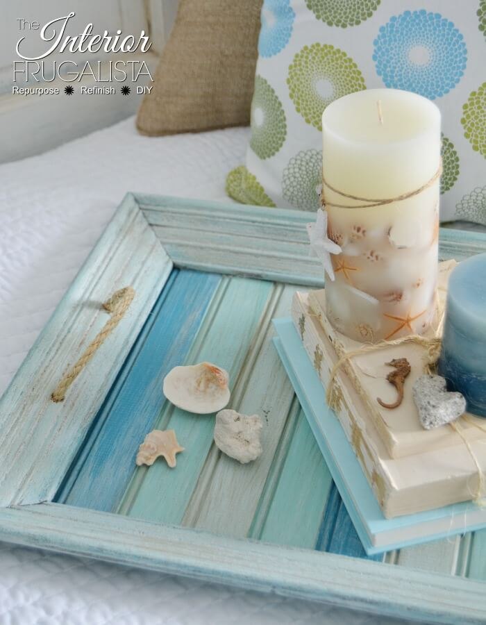 A picture frame craft idea that turns an thrift store frame into a coastal farmhouse tray.