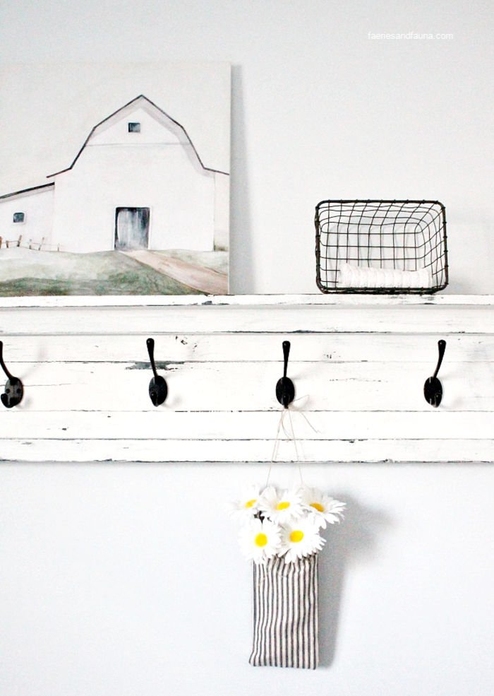 A handmade fabric pouch craft hanging on a shelf for farmhouse decor.