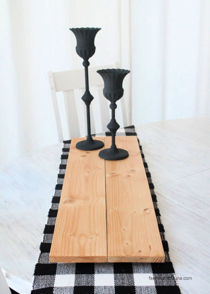Large table riser made with wood for rustic farmhouse kitchen decor.