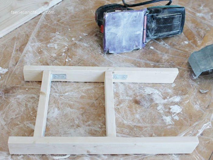 Sanding a small DIY kitchen ladder for tea towels.