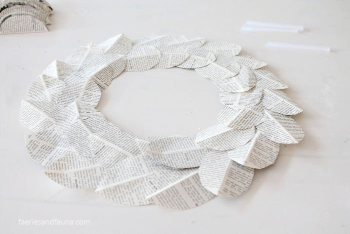 Making a DIY book page wreath.