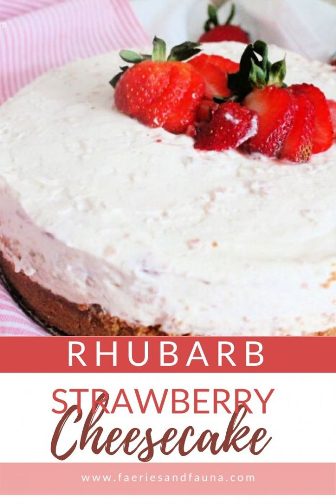 A large pink strawberry and rhubarb cheesecake with sliced strawberries on top.