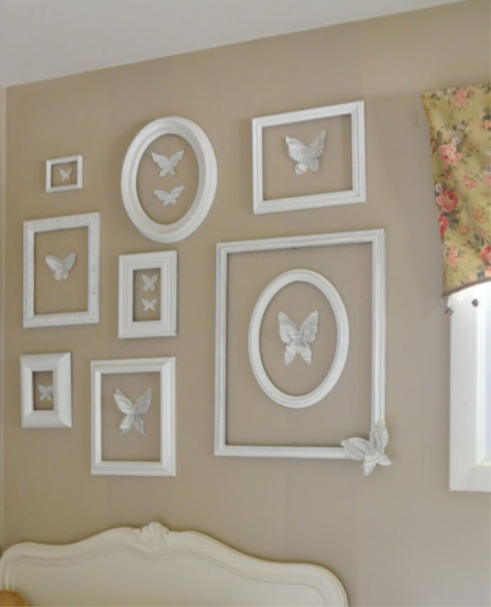A DIY wall art idea using paper butterflies and upcycled picture frame.