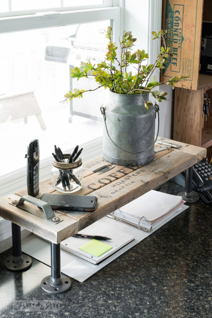 DIY wood and metal industrial farmhouse shelf for the office. Decorated with galvanized decor, a plant and office supplies.