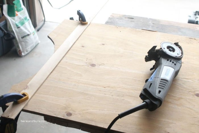 Cutting plywood to make a faux farmhouse door.