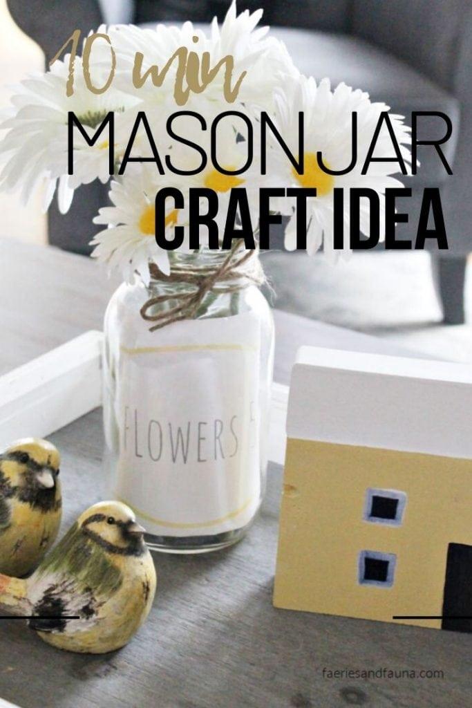 Upcycling an old jar into a pretty mason jar vase with flowers for DIY farmhouse decor.