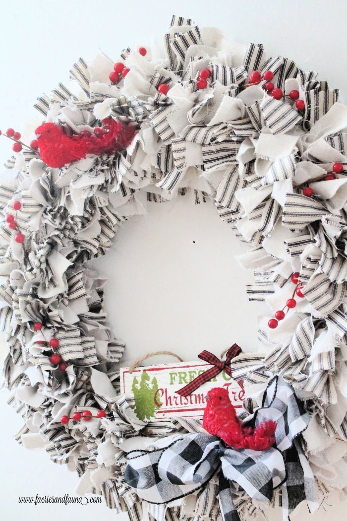 A DIY drop cloth craft wreath with ticking decorated for Christmas