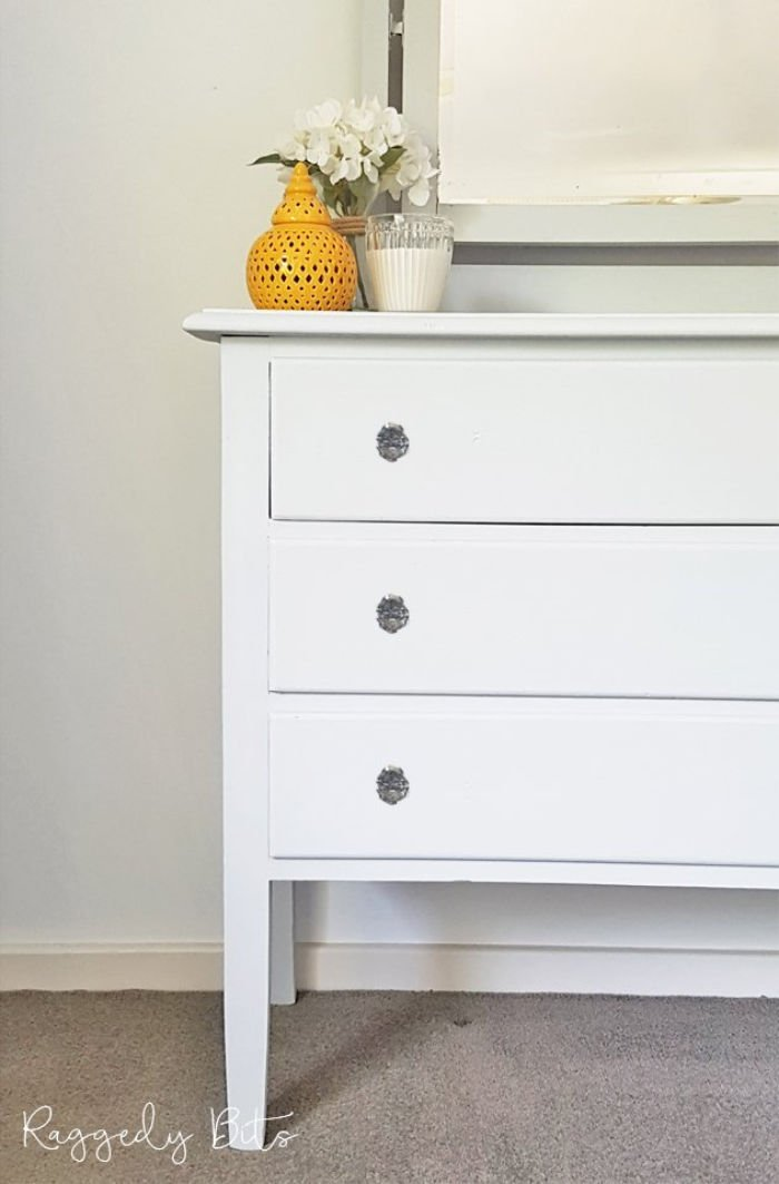 White vintage dresser refinished in white paint.