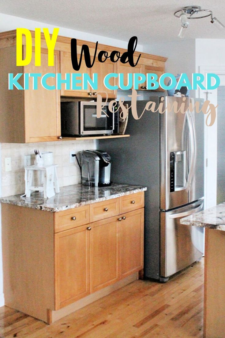 A set of wood kitchen cabinets refinished with light stain, not paint.