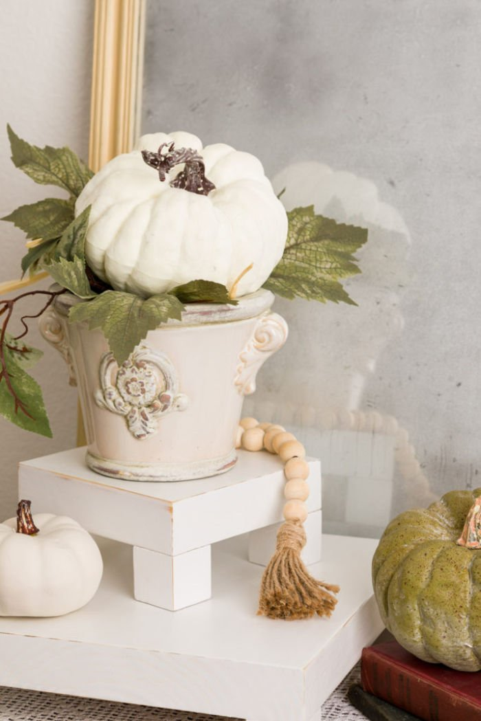 White DIY Farmhouse decor riser decorated with farmhouse beads for a pretty farmhouse vignette.