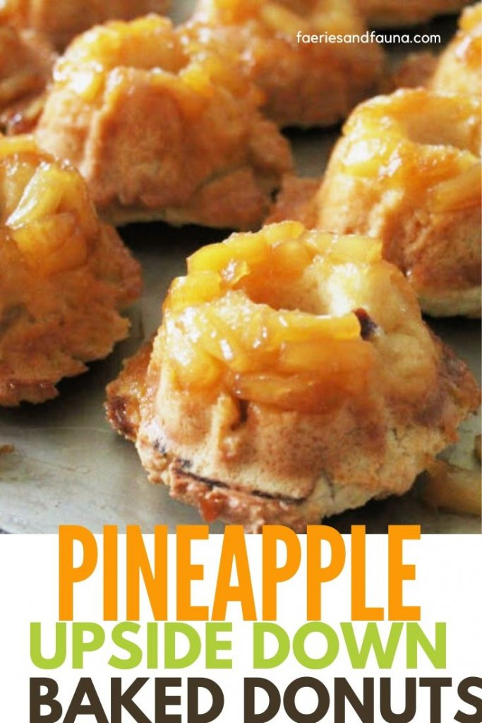 Pineapple baked cake donuts with sour cream on a counter cooling. A twist on pineapple upside down cake so pineapple tidbits are on top