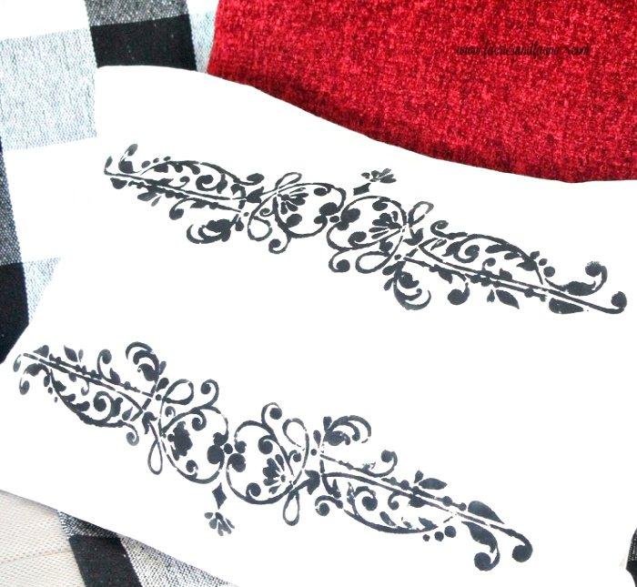 Handmade cushion drop cloth craft idea, a french seams envelope cushion with black stencil.