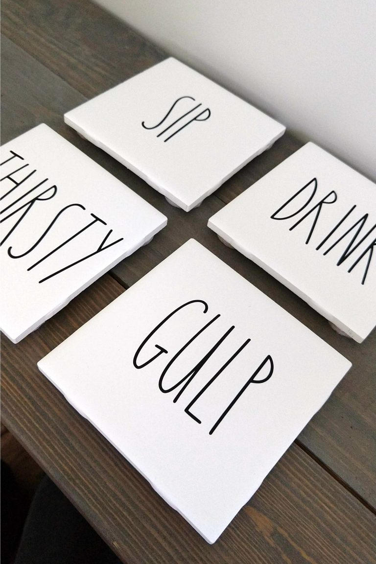 DIY Rae Dunn inspired coffee coasters that say Sip, thirsty, gulp and drink. Fun and unique in white wood with black lettering.