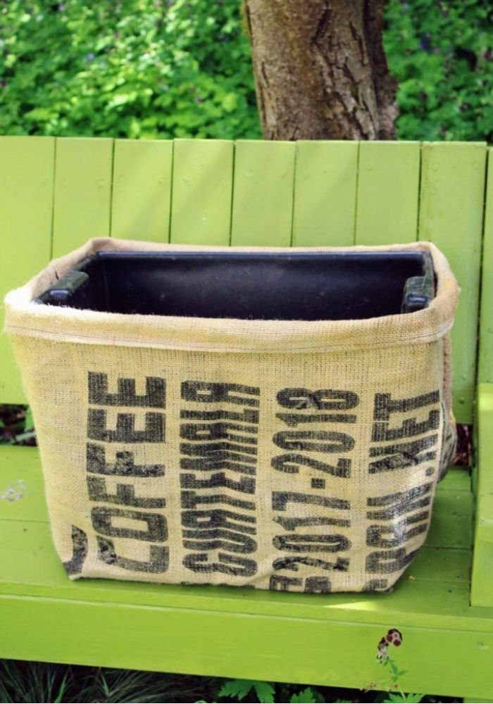 An upcycled box covered with an old burlap coffee bag
