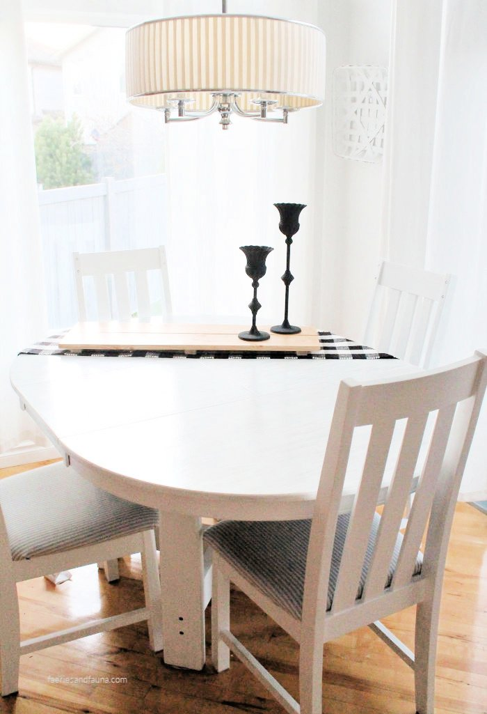 A refinished table and chairs in white with a DIY stained top and white painted chairs.
