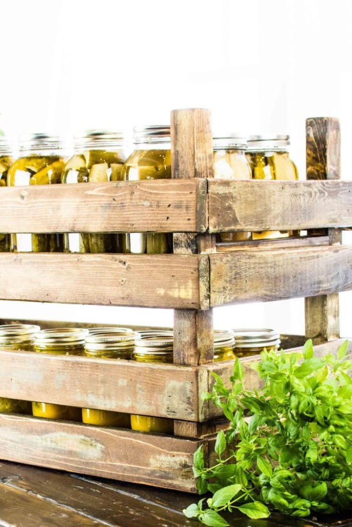 DIY stackable crates holding jars for farmhouse storage.