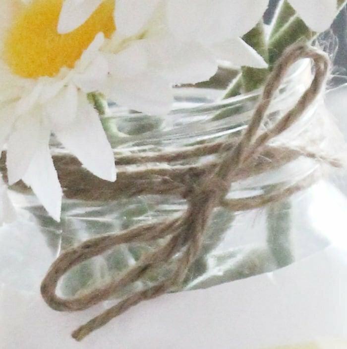 Where to tie a twine bow around a mason jar craft idea.