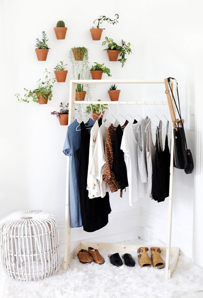 Pretty Wooden DIY clothing rack in white, with a pretty wardrobe hanging on it.